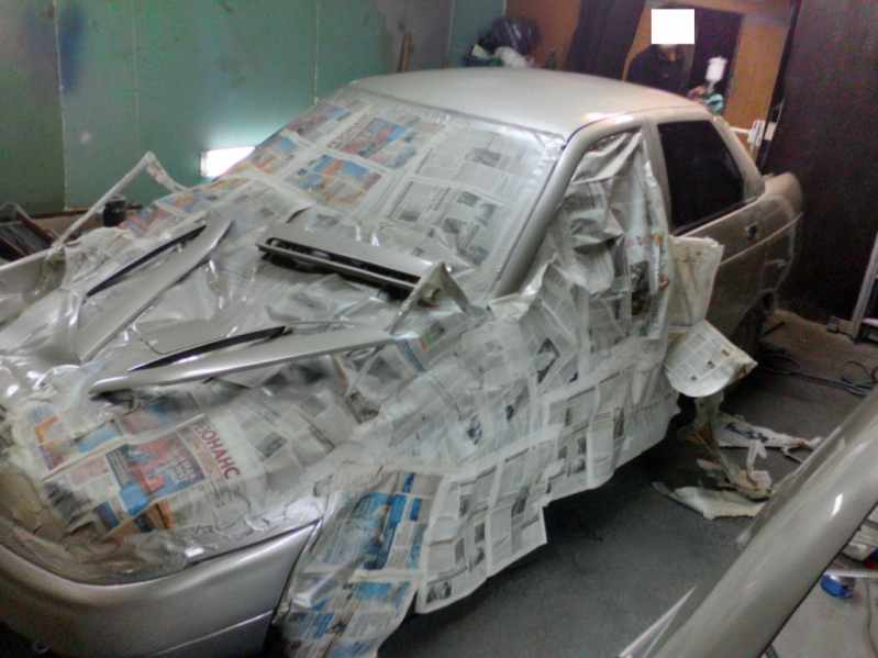 Заклееная машина при покраске